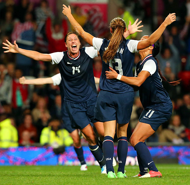 Alex Morgan (13) celebrates with teammates Sydney Leroux (11) and Abby Wambach (left) after she scored in extra time to push the U.S. past Canada and into the gold medal match.