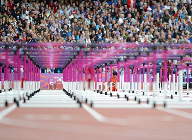A row of hurdles awaits Olympians competing in the men's 110-meter hurdles preliminary races.