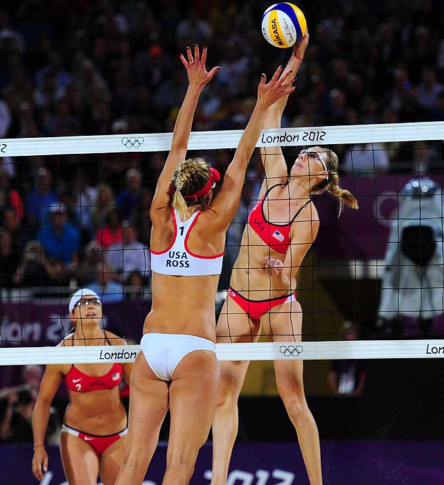 Misty May-Treanor and Kerri Walsh won their third consecutive gold medal in beach volleyball on Wednesday, getting past their American counterparts Jennifer Kessy and April Ross, surprise winners over Brazil.
