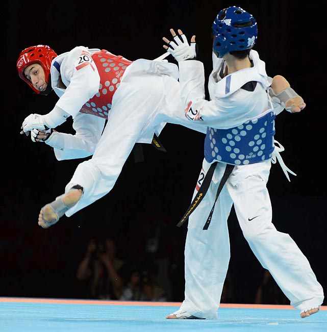 Despite a strong aerial attack,  Alexey Denisenko (left) of Russia lost his taekwondo semifinal to Lee Daehoon of South  Korea in the 58 kg class.