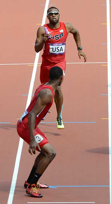 "Manteo Mitchell completes the second leg of the 4x400 relay for the U.S., even though he had suffered a broken left fibula halfway through his lap. Shortly after handing the baton off to his teammate, Mitchell reached down and felt the area covered by the blue tape on his leg. ""It felt like somebody literally just snapped my leg in half,"" he said in describing the moment he felt the leg break. Mitchell finished his heat in 46.1 seconds to help the injury-riddled U.S. team qualify for the final."