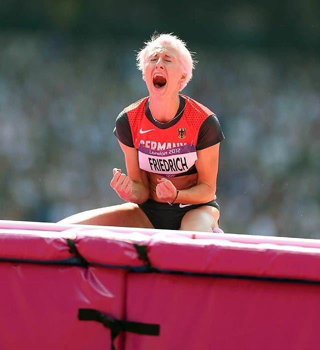 Ariane Friedrich of Germany screams after attempting to clear the bar in the qualifying round of the high jump.