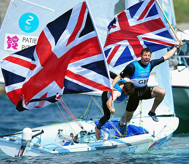 Luke Patience (left) and Stuart Bithell of Great Britain celebrate their silver medal after finishing second in the men's 470 sailing.