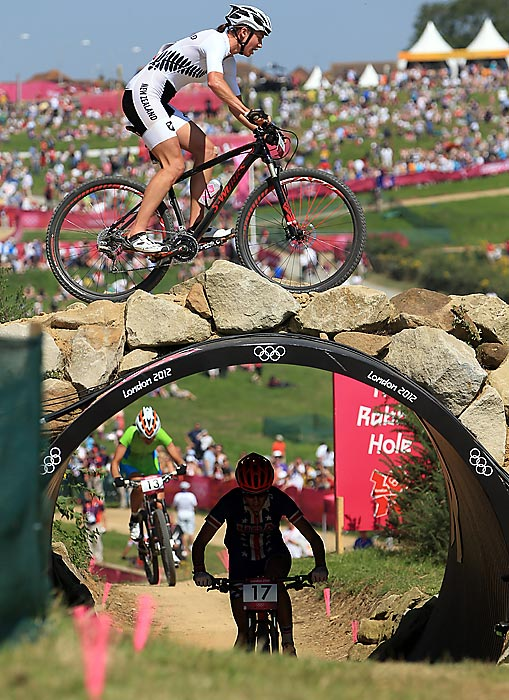 Karen Hanlen of New Zealand competes in the mountain Bike race.