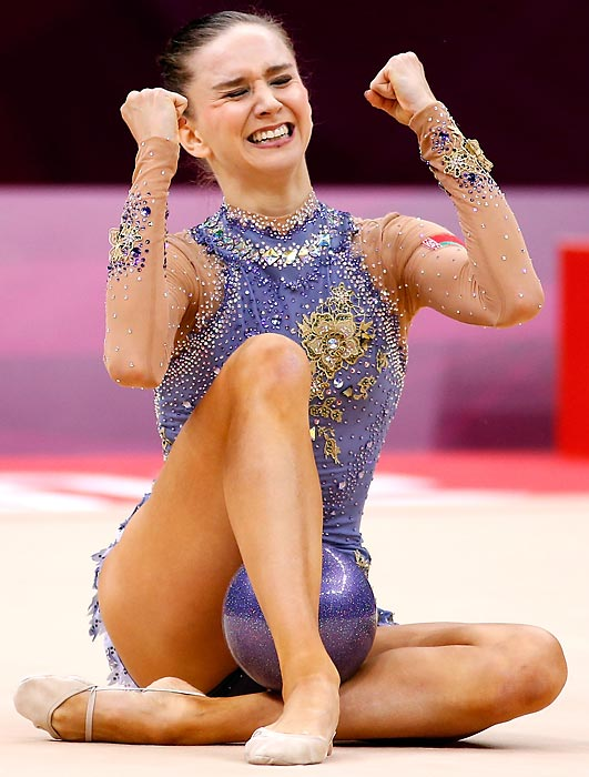 Liubou Charkashyna of Belarus celebrates after competing in the Individual All-Around Rhythmic Gymnastics final.