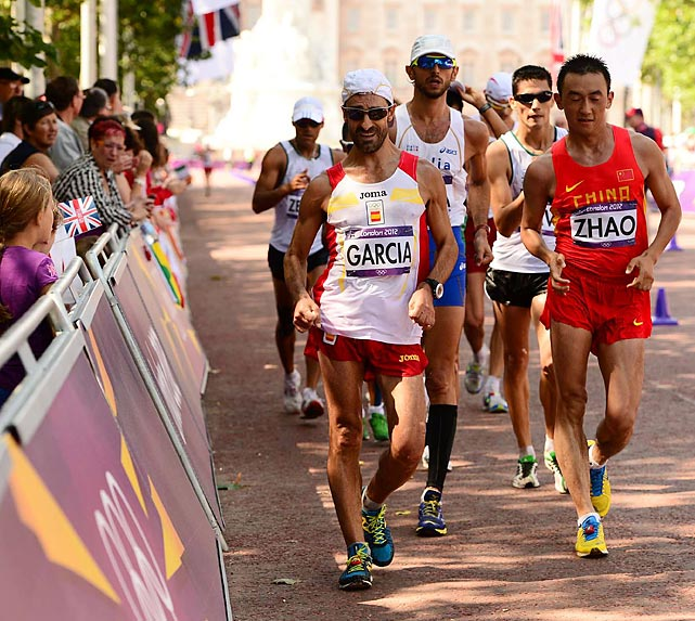 Olympians compete in the 50km race walk, an event won by Russia's Sergey Kirdyapkin in an Olympic record time of three hours 35 minutes 59 seconds.