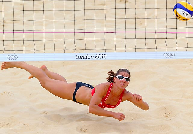 Canada's Annie Martin, 30, lays out for a shot on Thursday in a match against world No. 6 Italy during the preliminary round of the Women's Beach Volleyball competition at Horse Guards Parade. Partnered with 34-year-old Marie-Andree Lessard, Martin's efforts were not enough as the Canadian pair dropped the three-setter, 21-12, 22-24, 15-8, ending their Olympic bid, as well as their playing careers.