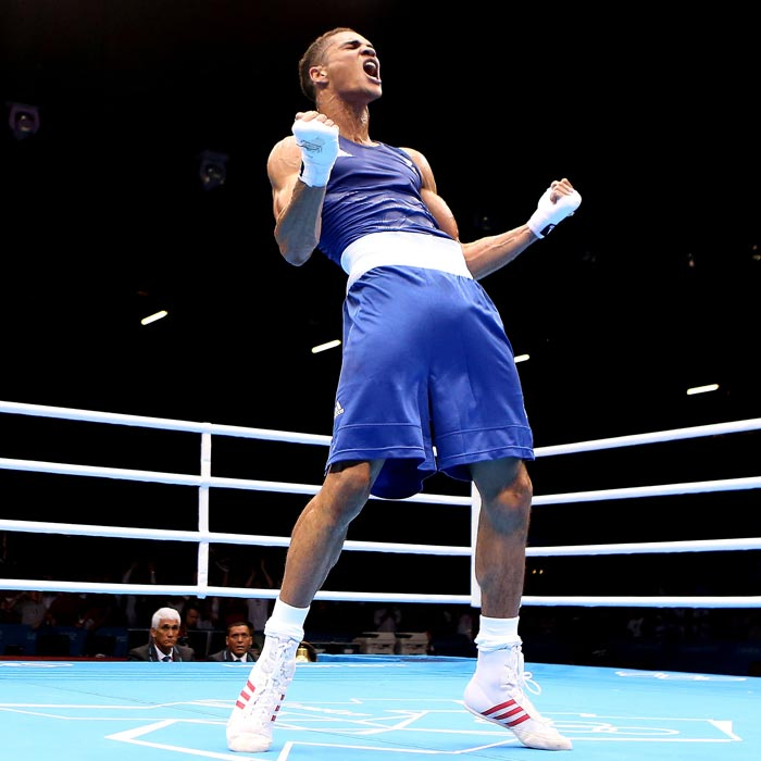British boxer Anthony Ogogo celebrates his victory over Levgen Khytrov of Ukraine in a middleweight (75kg) bout.