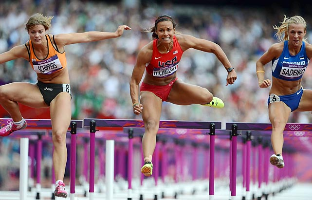 Young American heptathlete Chantae McMillan puts all of her energy into the last hurdle as she battles the Dafne Schippers from the Netherlands and Grit Sadeiko of Estonia.
