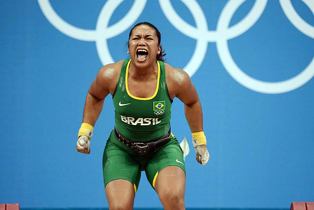 Jaqueline Ferreira of Brazil celebrates after successfully lifting 230kg during the women's 75kg final. Although it was not enough to medal, it was an achievement for Brazil, which hasn't had a woman Olympic weightlifter since 2000 in Sydney.