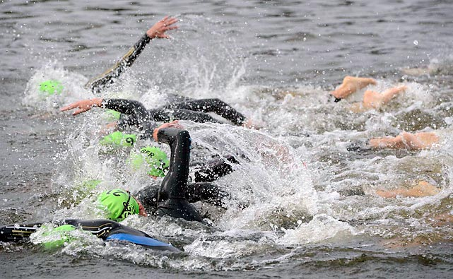 Fifty-five woman triathletes battled their way through the opening 1.5-km swim leg in the Serpentine in Hyde Park. Nicola Spirig of Switzerland eventually won gold in a photo finish over Lisa Norden of Sweden.
