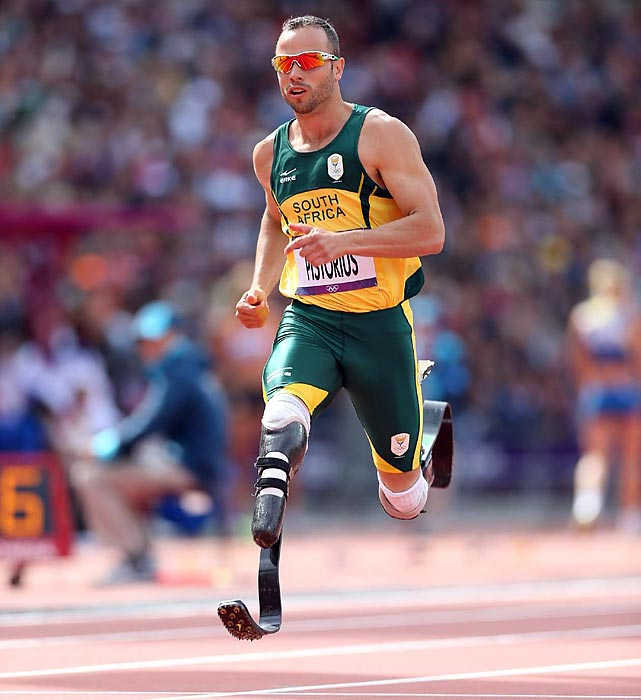 Oscar Pistorius, the first amputee to compete in an Olympic track event, advanced to Sunday's semifinals in the 400 meters by finishing second in his qualifying heat.