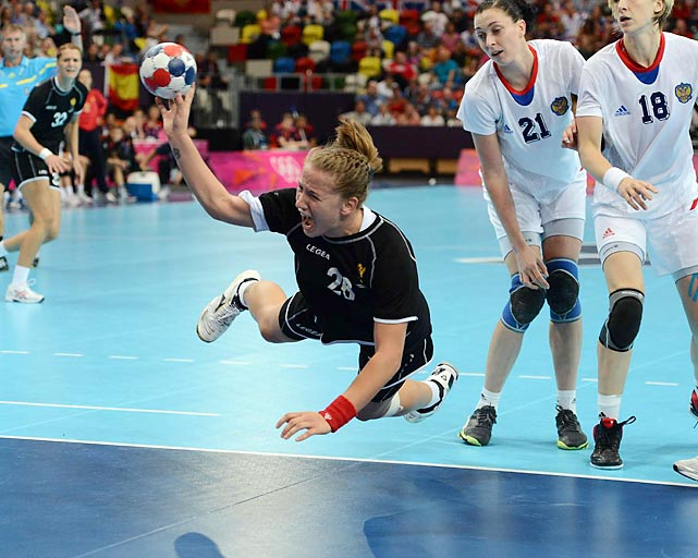 Suzana Lazovic of Montenegro launched a screaming shot on goal in her team's 25-25 handball tie with Russia.