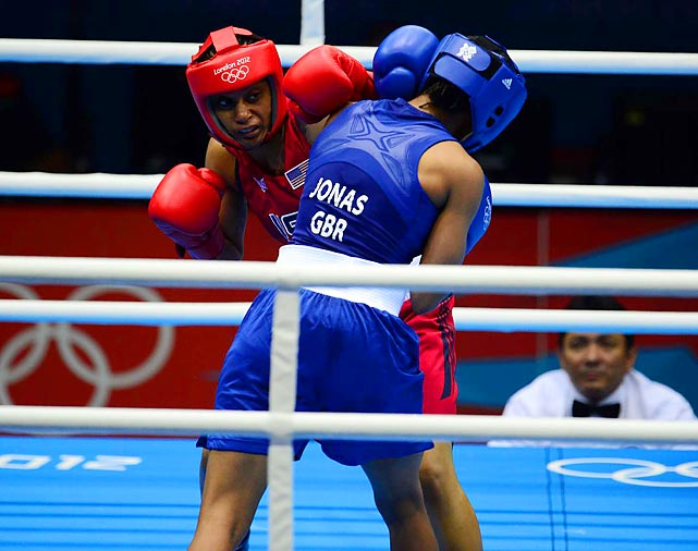 Britain's Natasha Jonas punches her way to a 21-13 victory over Quanitta Underwood of the U.S. during a lightweight bout in the round of 16.