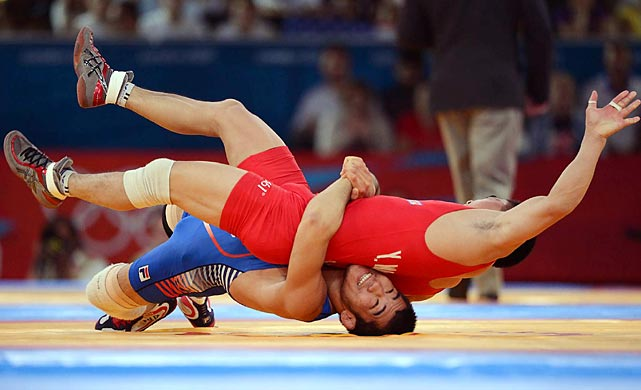 Nevin Zugaj of Croatia (blue) defeated Tolba Estam of Egypt during their Greco Roman match.