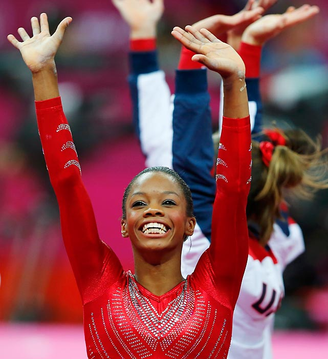 Gabby Douglas celebrates the women's gymnastics Team USA victory, claiming the gold with a full 5 point lead over the silver medaled Russian team.