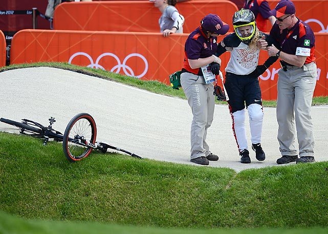 Costa Rica's Leonardo Chacon has to be helped off the course after he fell off his bike at the end of the men's BMX competition.