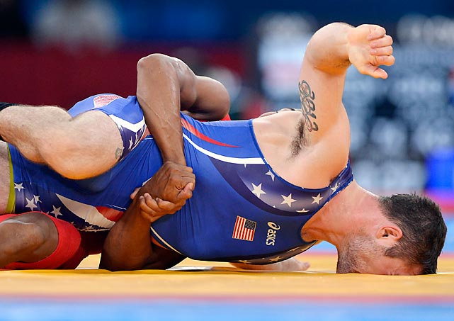 Benjamin Provisor of the U.S. gets his face planted right into the mat as he wrestles Cuba's Alexei Bel in a Greco-Roman 74kg class qualification match.