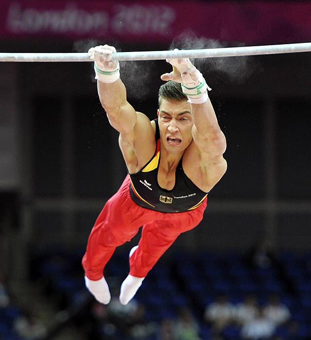 Philipp Boy of Germany misses his grip on the uneven bars.