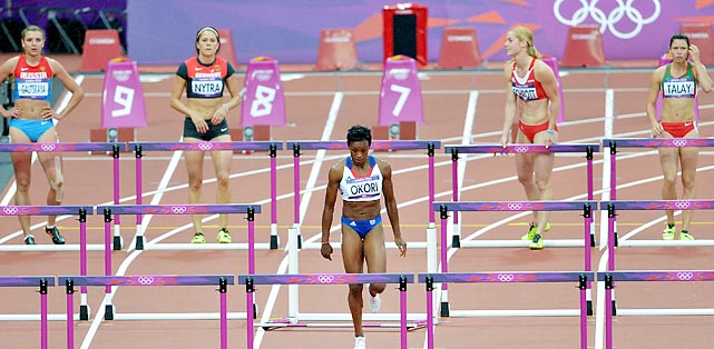 Okori Reina-Flor of France stops running after realizing she false-started during the 100-meter hurdles semifinal.