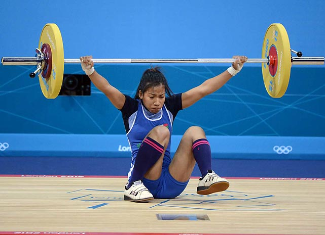Harinelina Rakotondramanana of Madagascar falls during her lift in the women's 48kg event.