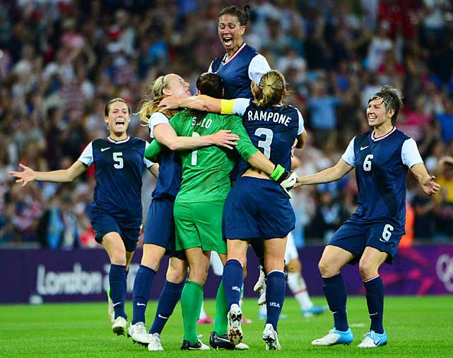 The U.S. team celebrates its gold medal performance.