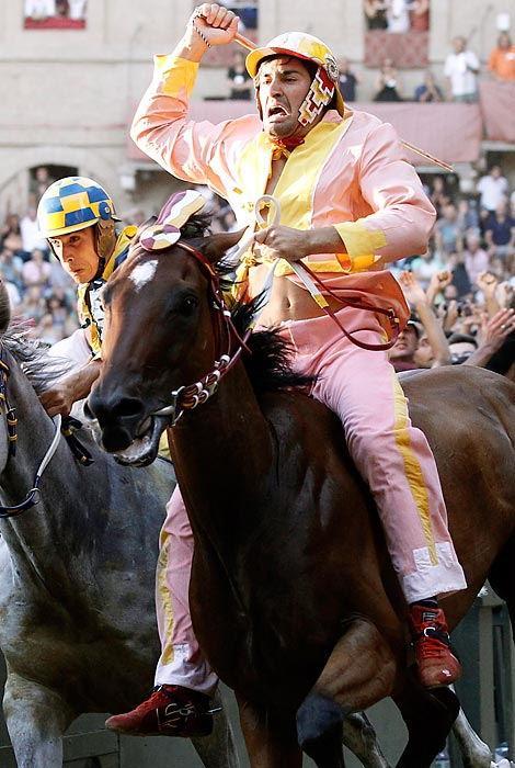 Twice a year, every July and August, the cobblestones of this Tuscan hill town's Piazza del Campo are covered with a thick layer of dirt, and its stone walls are layered with mattresses, so that 10 mixed-breed horses and their saddleless riders can compete for the honor of their respective districts. Known to the locals as simply Il Palio, the race was first run in 1656 to celebrate an apparition of the Virgin Mary. It lasts 90 seconds but generates feuds that continue for decades.  This year, the Montone neighborhood rider Jonathan Bartoletti and his horse Moedi, (left) won the August run.