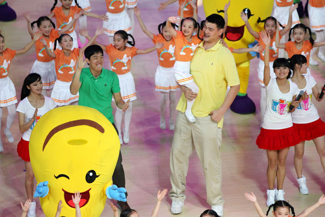 Chinese hurdler Liu Xiang and Yao Ming attend the opening ceremony for the First Citizens Games of Shanghai at the Shanghai Oriental Sports Center.