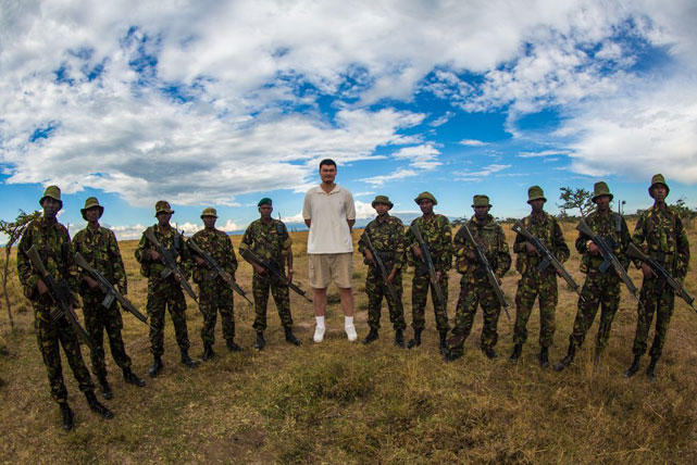 Yao poses with a group of Kenyan Police Reservists protecting Ol Pejeta, an animal sanctuary in East Africa.