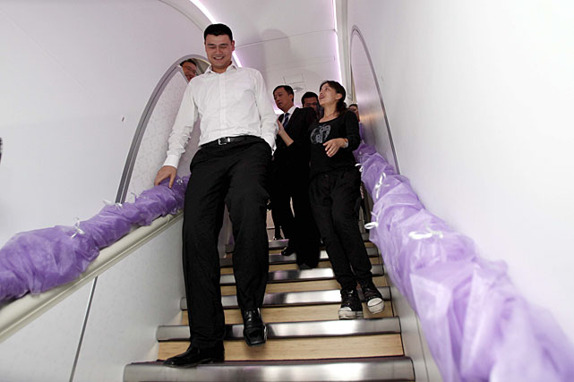 Yao walks on the first Airbus A380 delivered to China Southern Airlines at the Beijing Capital International Airport.