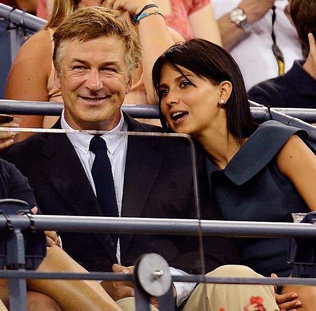 Alec Baldwin and his wife Hilaria Thomas watch Victoria Duval of the U.S. play Kim Clijsters of Belgium at the 2012 U.S. Open Tennis Championship.