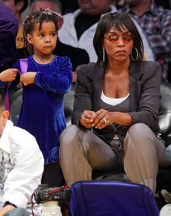 Angela Bassett and her daughter, Bronwyn Golden Vance, attend a game between the Miami Heat and the Los Angeles Lakers at Staples Center.