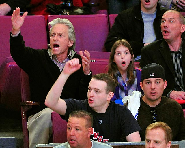 Michael Douglas and daughter Carys Zeta Douglas at a Washington Capitals- New York Rangers game at Madison Square Garden.