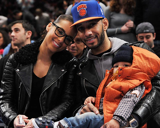 Alicia Keys and her son Egypt with producer Swizz Beatz during a game between the Boston Celtics and New York Knicks at Madison Square Garden.