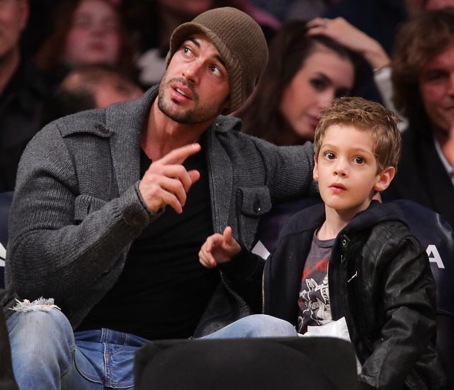 William Levy and his son Christopher Alexander watch the Denver Nuggets and the Los Angeles Lakers at Staples Center.