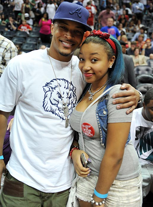 Recording artist/actor T.I. and his daughter Star attend a Boston Celtics-Atlanta Hawks playoff game at Philips Arena in Atlanta.