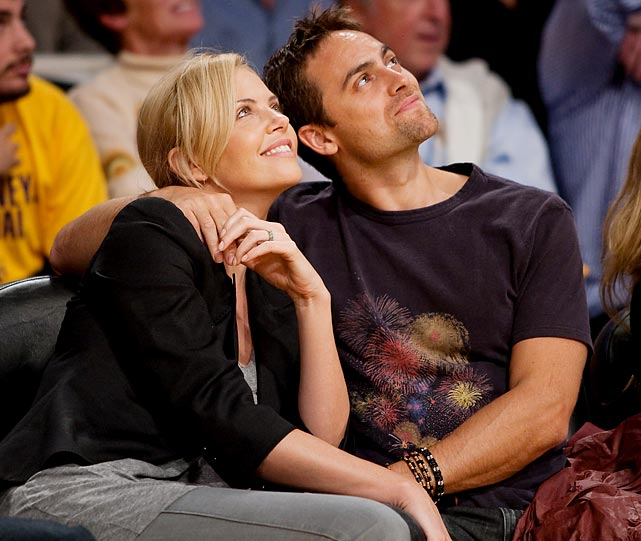 Charlize Theron and actor Stuart Townsend at a Lakers-Clippers game in Los Angeles.