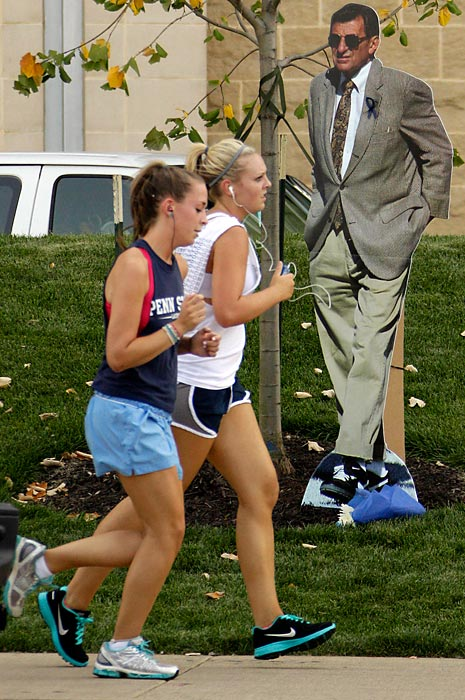 A cardboard cutout of former Penn State coach Joe Paterno stands near the former site of Paterno's nine-foot bronze statue.