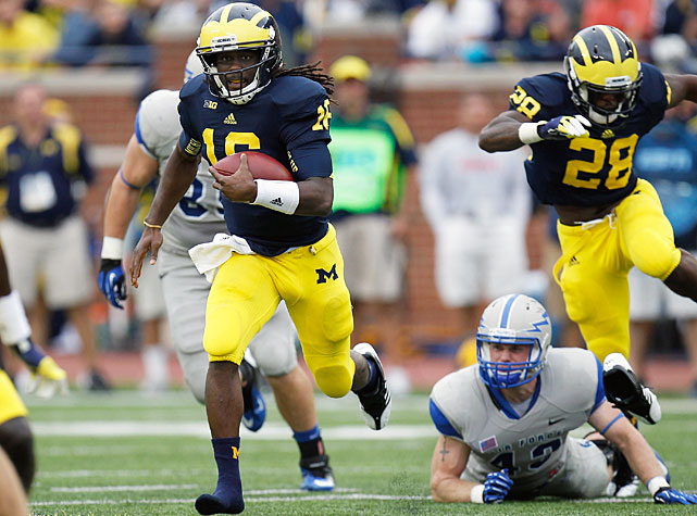 It was close throughout, but Michigan escaped with a 31-25 victory over Air Force in Week 2. Denard Robinson (pictured) rushed for 218 yards, passed for 208 yards and scored four total touchdowns, and freshman wide receiver Devin Funchess broke out with four catches for 101 yards and a score. The Woverines will look impove to 2-1 while hosting UMass next weekend.