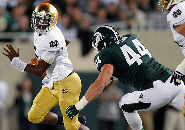 "Everett Golson made plays with his arms and legs, and an inspired Manti Te'o helped Notre Dame's defense smother Michigan State. The Fighting Irish are off to their best start in 10 years, with the type of marquee victory that's eluded them for almost as long. Golson (left) threw a touchdown pass and ran for a score in the first half to help the Fighting Irish dominate the Spartans. The Irish (3-0) snapped a six-game losing streak against ranked teams and beat a top-10 opponent for the first time in seven years. ""It's a signature win,"" third-year Notre Dame coach Brian Kelly said."
