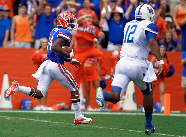 Florida easily extended its winning streak against SEC East foe Kentucky to 26 games, overcoming a slow start to throttle the Wildcats. Jaylen Watkins (pictured) and the Florida defense intercepted three Kentucky passes, holding the Wildcats to 60 passing yards. Florida quarterback Jeff Driskel, meanwhile, passed for 203 yards, one touchdown and one interception and rushed for an additional score.