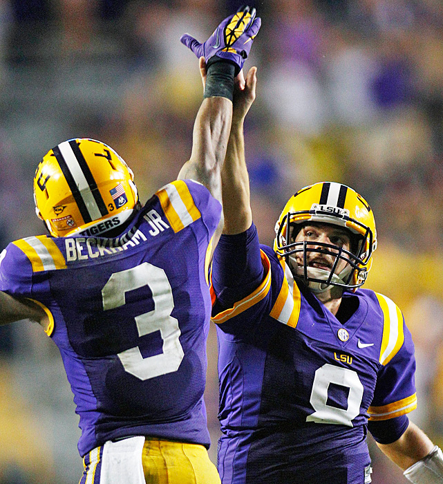 "Zach Mettenberger's (right) perfectly placed 53-yard scoring strike to Odell Beckham Jr. exemplified the type of play Les Miles wanted to see from LSU's offense before the Tigers hit one of the toughest stretches on their schedule. If only that play had been the norm instead of the exception in a mistake-filled outing, Miles might not have been describing a ""somber locker room"" following LSU's win. Mettenberger hit Beckham five times for 128 yards and two touchdowns."