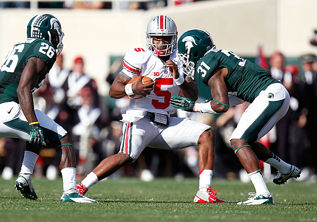 Urban Meyer officially has his first Big Ten win as Ohio State's head coach. The Buckeyes improved to 5-0 after taking down Michigan State in East Lansing, a victory powered by quarterback Braxton Miller (pictured). Miller passed for 179 yards, rushed for 135 yards and had one touchdown, while wideout Devin Smith reeled in the game-winning 63-yard score.  Touted running back Le'Veon Bell was limited to just 49 yards on 17 carries for the Spartans.