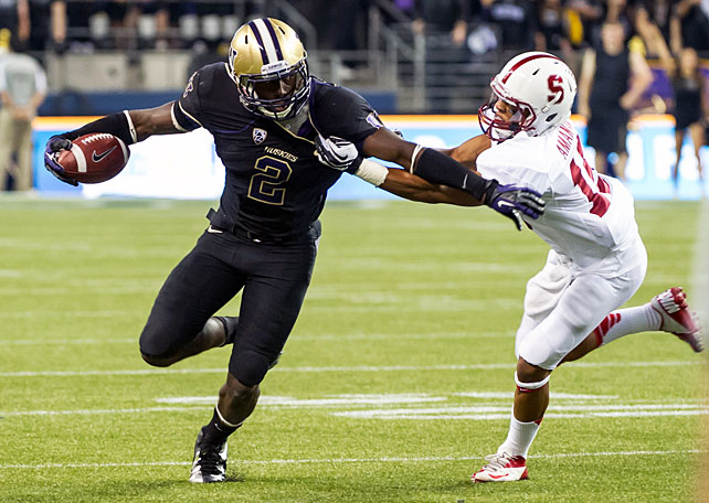 Two weeks after its statement victory over USC in Palo Alto, Stanford found itself on the wrong side of a major upset Thursday night. Washington upended the No. 8 Cardinal by scoring the final 14 points of the game, the last of which came on a 35-yard catch-and-run by wideout Kasen Williams (pictured). Huskies running back Bishop Sankey collected 20 carries for 137 yards and a touchdown, while Stanford back Stepfan Taylor was held in check, finishing with just 21 carries for 75 yards.
