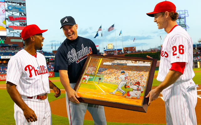 Chase Utley and Jimmy Rollins presented Jones with a painting of one of his many plate appearances against the Phillies. For all his noted success against the Mets, his 49 homers against the Phillies ties him with the most against any opponent.