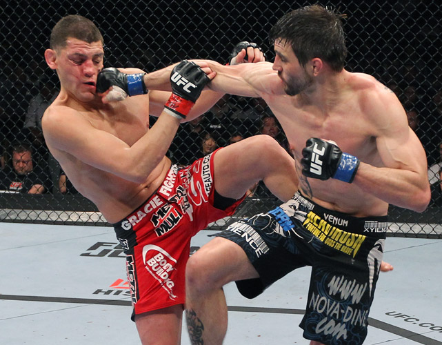 With Georges St-Pierre sidelined by an ACL injury, Carlos Condit beat Nick Diaz for the interim welterweight title at UFC 143. Condit is scheduled to fight St-Pierre for the undisputed championship at UFC 154.