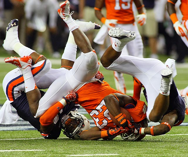 Auburn's Jonathan Mincy (6) and Ikeem Means (16) tackle Clemson running back Andre Ellington during the first half of Clemson's 26-19 victory over Auburn. Ellington rushed for 231 yards on 26 carries.