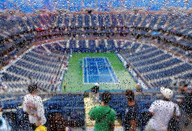 Fans move around Arthur Ashe Stadium during a rain delay in the quarterfinals match between Australia's Samantha Stosur and Belarus's Victoria Azarenka. Azarenka would win the match before losing to Serena Williams in the final.