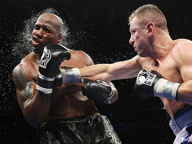 Tomasz Adamek, right, of Poland, lands a punch on Travis Walker during the fifth round of a heavyweight boxing match at the Prudential Center in Newark, N.J.,