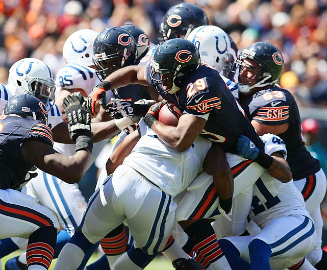 Chicago's Michael Bush tries to shed the grip of Indianapolis's Antoine Bethea and plunge through the Colts defensive line. Bush carried the ball 12 times for 42 yards and two touchdowns.